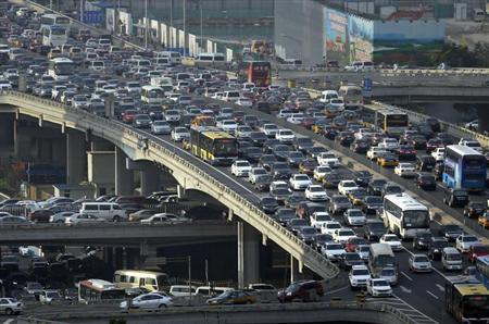 Lines of cars are pictured during a rush hour traffic jam on Guomao Bridge in Beijing July 11, 2013. REUTERS/Jason Lee