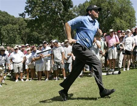 Phil Mickelson of the U.S. runs to look at his shot from the rough at the fifth hole during the first round of the 89th PGA Championship golf tournament at Southern Hills Country Club in Tulsa, Oklahoma, August 9, 2007. REUTERS/Eric Miller