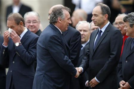 (L-R) Paris Mayor Bertrand Delanoe, Francois Bayrou, France's centrist MoDem party leader, French UMP political party head Jean-Francois Cope and Jean-Louis Borloo, head of the Union Democratic Independant (UDI), arrive to attend a ceremony to pay tribute to late former French Prime Minister Pierre Mauroy in the courtyard of the Invalides in Paris June 11, 2013. REUTERS/Charles Platiau