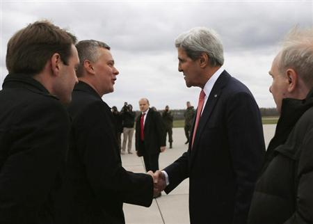 U.S. Secretary of State John Kerry (2nd R) is greeted by Poland's Defence Minister Tomasz Siemoniak (2nd L) upon his arrival at Lask Air Force Base in Poland, November 5, 2013. REUTERS/Jason Reed