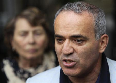 Former world chess champion and opposition leader Garry Kasparov speaks to the media after walking out of a court building in Moscow, August 24, 2012. REUTERS/Sergei Karpukhin