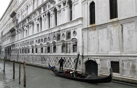 A gondolier rows his gondola in a canal in Venice February 11, 2012. REUTERS/Stefano Rellandini