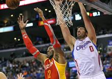 Los Angeles, CA, USA; Houston Rockets center Dwight Howard (12) and Los Angeles Clippers center Byron Mullens (0) play for the rebound during the second half at Staples Center. Mandatory Credit: Gary A. Vasquez-USA TODAY Sports