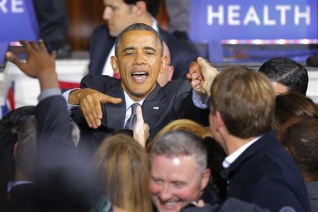 U.S. President Barack Obama greets audience members after speaking about the Affordable Care Act, also known as Obamacare, at Faneuil Hall in Boston, Massachusetts October 30, 2013. REUTERS/Brian Snyder
