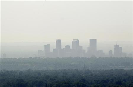 The downtown skyline of Denver, Colorado is obscured by smoke June 24, 2012. REUTERS/Rick Wilking