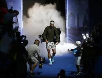 O espanhol Rafael Nadal chea a partida de tênis contra o compatriota David Ferrer na estreia do ATP Finals na arena O2 em Londres, Reino Unido. 5/11/2013 REUTERS/Eddie Keogh