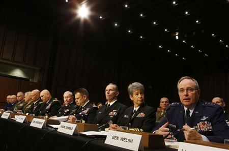 Air Force Chief of Staff Gen. Mark A. Welsh III (R) testifies about pending legislation regarding sexual assaults in the military at a Senate Armed Services Committee on Capitol Hill in Washington, June 4, 2013. REUTERS/Larry Downing