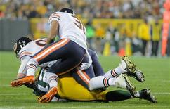 Green Bay, WI, USA; Chicago Bears defensive end Shea McClellin (99) and cornerback Isaiah Frey (31) sacks Green Bay Packers quarterback Aaron Rodgers (12) in the 1st quarter at Lambeau Field. Rodgers left the game with a hand injury after the play. Mandatory Credit: Benny Sieu-USA TODAY Sports