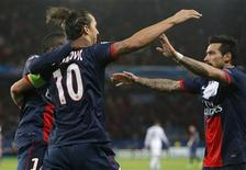 Paris St-Germain's Zlatan Ibrahimovic (L) celebrates with team mates after scoring his team's first goal during their Champions League soccer match against Anderlecht at the Parc des Princes Stadium in Paris November 5, 2013. REUTERS/Gonzalo Fuentes