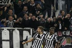 Juventus Fernando Llorente (L) celebrates with his teammate Paul Pogba after scoring against Real Madrid during their Champions League soccer match at Juventus stadium in Turin November 5, 2013. REUTERS/Max Rossi