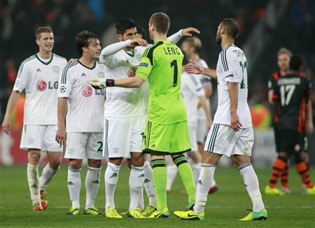 Bayer Leverkusen's players greet each other after their Champions League soccer match against Shakhtar Donetsk at the Donbass Arena stadium in Donetsk November 5, 2013. REUTERS/Gleb Garanich