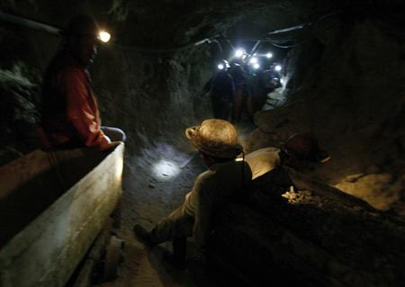 Bolivian miners enter a mine deep within the Cerro Rico mountain in Potosi, in this file picture taken February 26, 2008. REUTERS/David Mercado