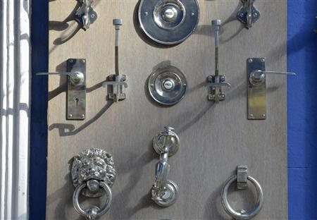 Bells, handles and buzzers for front doors are seen for sale at a shop in central London October 8, 2013. REUTERS/Toby Melville