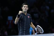 Novak Djokovic of Serbia celebrates after defeating Roger Federer of Switzerland in their men's singles tennis match at the ATP World Tour Finals at the O2 Arena in London November 5, 2013. REUTERS/Eddie Keogh