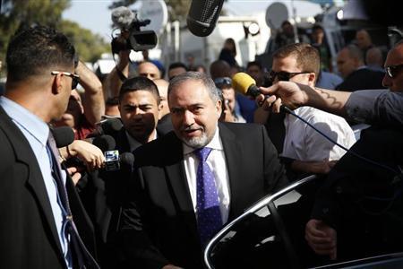 Former Israeli Foreign Minister Avigdor Lieberman, (C) steps out of a car as he arrives to hear the verdict in the corruption charges against him at the Magistrate Court in Jerusalem November 6, 2013. Lieberman, a key ally of Prime Minister Benjamin Netanyahu, will hear on Wednesday whether or not he has been found guilty of corruption. REUTERS/Darren Whiteside