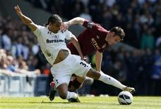 Tottenham Hotspur's Benoit Assou-Ekotto (L) challenges Manchester City's James Milner during their English Premier League soccer match at White Hart Lane in London April 21, 2013. REUTERS/Stefan Wermuth