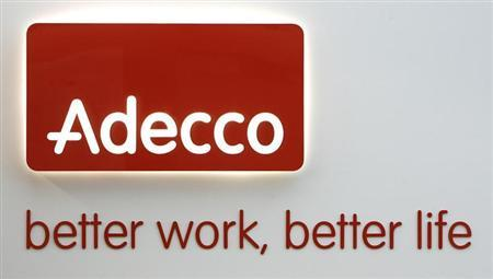 An Adecco logo is pictured at the company's headquarters in Glattbrugg near Zurich December 15, 2008. REUTERS/Christian Hartmann