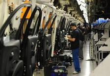 Employees work on cars on the Nissan production line at the company's factory in Washington, northern England in this March 20, 2009 file photo. REUTERS/Nigel Roddis/Files