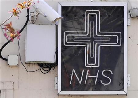 An NHS sign is seen outside a pharmacy in west London April 4, 2011. REUTERS/Toby Melville