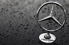 The emblem of German car manufacturer Mercedes-Benz, a subsidiary of Daimler AG, is pictured covered with raindrops at a parking lot in Hanau, 30km (19 miles) south of Frankfurt October 23, 2013. REUTERS/Kai Pfaffenbach