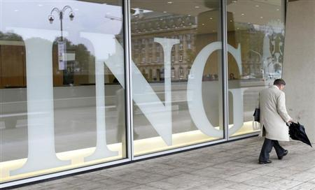 A pedestrian walks past the logo of ING bank by the entrance of the group's main office in Brussels November 6, 2013. REUTERS/Francois Lenoir