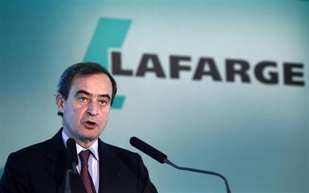 Bruno Lafont, CEO of French building material Lafarge, speaks during a news conference to present the company's 2011 annual results in Paris February 17, 2012. REUTERS/Jacky Naegelen