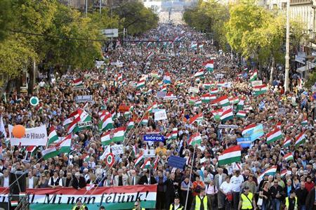 Hungarians march at a pro-government demonstration in Budapest October 23, 2013. REUTERS/Laszlo Balogh