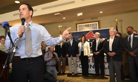 U.S. Senator Marco Rubio (R-FL) makes remarks as he stumps for Virginia gubernatorial Republican candidate Ken Cuccinelli (C, background with wife Tiero), Attorney General candidate Mark Obenshain (3rd R) and Lieutenant Governor candidate EW Jackson (R), during a ''Get Out the Vote'' rally, in Warrenton, Virginia, November 4, 2013. REUTERS/Mike Theiler