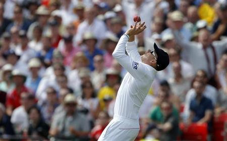 England's Jonny Bairstow catches the ball to take the wicket of Australia's Steve Smith off the bowling of Graeme Swann during the second day of the third Ashes test match at Old Trafford cricket ground in Manchester, northern England August 2, 2013. REUTERS/Phil Noble/Files