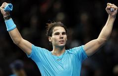 Rafael Nadal of Spain celebrates after winning his men's singles tennis match against Stanislas Wawrinka of Switzerland at the ATP World Tour Finals at the O2 Arena in London November 6, 2013. REUTERS/Suzanne Plunkett