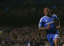 Chelsea's Samuel Eto'o celebrates after scoring a goal against FC Schalke 04 during their Champions League soccer match at Stamford Bridge in London November 6, 2013. REUTERS/Eddie Keogh