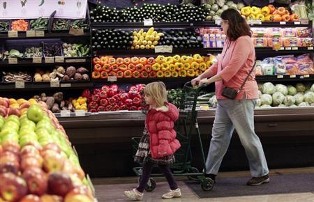 Customers shop in the produce section at the Whole Foods grocery story in Ann Arbor, Michigan, March 8, 2012. REUTERS/Rebecca Cook