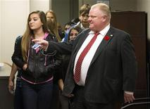 "Toronto Mayor Rob Ford gives children a tour of the office during ""Take Your Kids to Work Day"" at City Hall in Toronto, November 6, 2013. REUTERS/Mark Blinch"