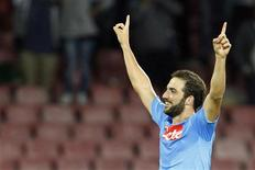 Napoli's Gonzalo Higuain celebrates after scoring against Olympique Marseille during their Champions League soccer match at San Paolo stadium in Naples November 6, 2013. REUTERS/Giampiero Sposito