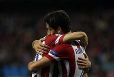 "Atletico Madrid's Raul Garcia (R) celebrates scoring against Austria Vienna with teammate Juan Francisco Torres ""Juanfran"" during their Champions League Group G soccer match at Vicente Calderon stadium in Madrid November 6, 2013. REUTERS/Susana Vera"
