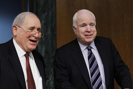 Chairman of the Senate homeland security and governmental affairs investigations subcommittee Carl Levin (D-MI) and ranking member John McCain (R-AZ) arrive at a hearing on offshore profit shifting and the U.S. tax code related to Apple Inc, on Capitol Hill in Washington, May 21, 2013. REUTERS/Jason Reed