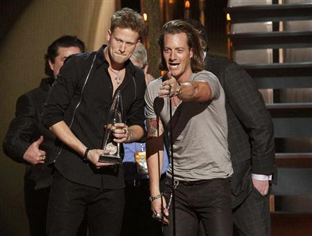 Brian Kelley (L) and Tyler Hubbard (R) of Florida Georgia Line accept the award for single of the year for ''Cruise'' at the 47th Country Music Association Awards in Nashville, Tennessee November 6, 2013. REUTERS/Harrison McClary