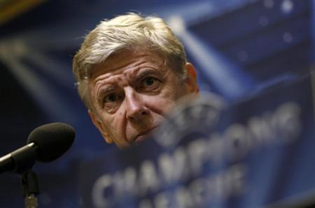 Arsenal's coach Arsene Wenger listens during a news conference in Dortmund November 5, 2013. REUTERS/Ina Fassbender