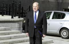 Ireland's Finance Minister Michael Noonan arrives at the Government Buildings before presenting his budget to parliament in Dublin October 15, 2013. REUTERS/Cathal McNaughton