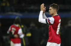 Arsenal's Aaron Ramsey celebrates after defeating Borussia Dortmund in their Champions League Group F soccer match in Dortmund November 6, 2013. REUTERS/Wolfgang Rattay
