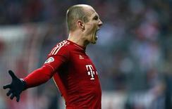 Arjen Robben of Bayern Munich celebrates his goal against Borussia Dortmund during their German soccer cup, DFB Pokal, quarter-final soccer match in Munich February 27, 2013. REUTERS/Kai Pfaffenbach
