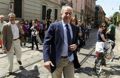 Giuliano Pisapia leaves a polling station after voting in downtown Milan May 29, 2011. REUTERS/Paolo Bona