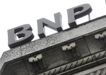 A part of the logo of the BNP Paribas bank is seen on the rooftop of their Paris headquarters April 26, 2012. T REUTERS/Mal Langsdon