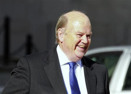 Ireland's Finance Minister Michael Noonan smiles as he arrives at the Government Buildings before presenting his budget to parliament in Dublin October 15, 2013. REUTERS/Cathal McNaughton