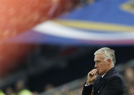 France's coach Didier Deschamps reacts during the 2014 World Cup qualifying soccer match against Finland at the Stade de France stadium in Saint-Denis, near Paris, October 15, 2013. REUTERS/Benoit Tessier