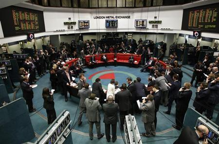 Traders and clerks react on the floor of the London Metal Exchange in the City of London February 14, 2012. REUTERS/Luke MacGregor