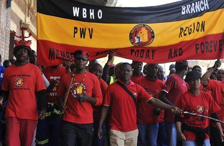 File picture of members of the National Union of Mineworkers (NUM) taking part in a strike in the central business district area of Johannesburg, August 27, 2013. REUTERS/Ihsaan Haffejee