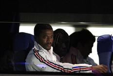 France's national soccer player Patrice Evra (L) sits in the team bus after arriving at the airport in Bloemfontein June 21, 2010. FREUTERS/Jorge Silva