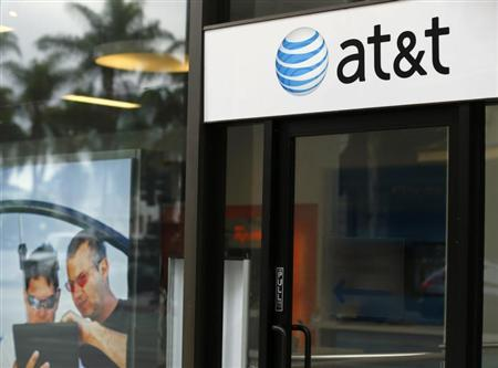 An AT&T wireless store front is pictured in in San Diego, California October 23, 2013. REUTERS/Mike Blake (