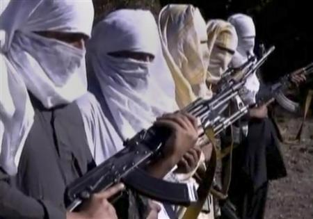 Pakistani Taliban fighters hold weapons as they receive training in Ladda, South Waziristan tribal region, in this still image taken from a video, shot between December 9 to December 14, 2011. REUTERS/Reuters TV